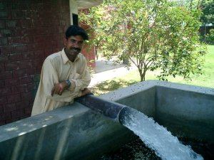 Farmer showing how generously his well is flowing